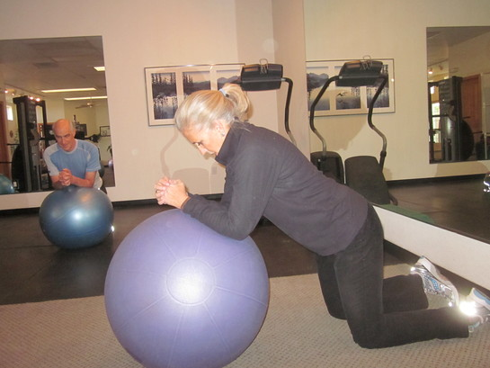 Man and Woman on a Ball Working out in Sante Fe, NM